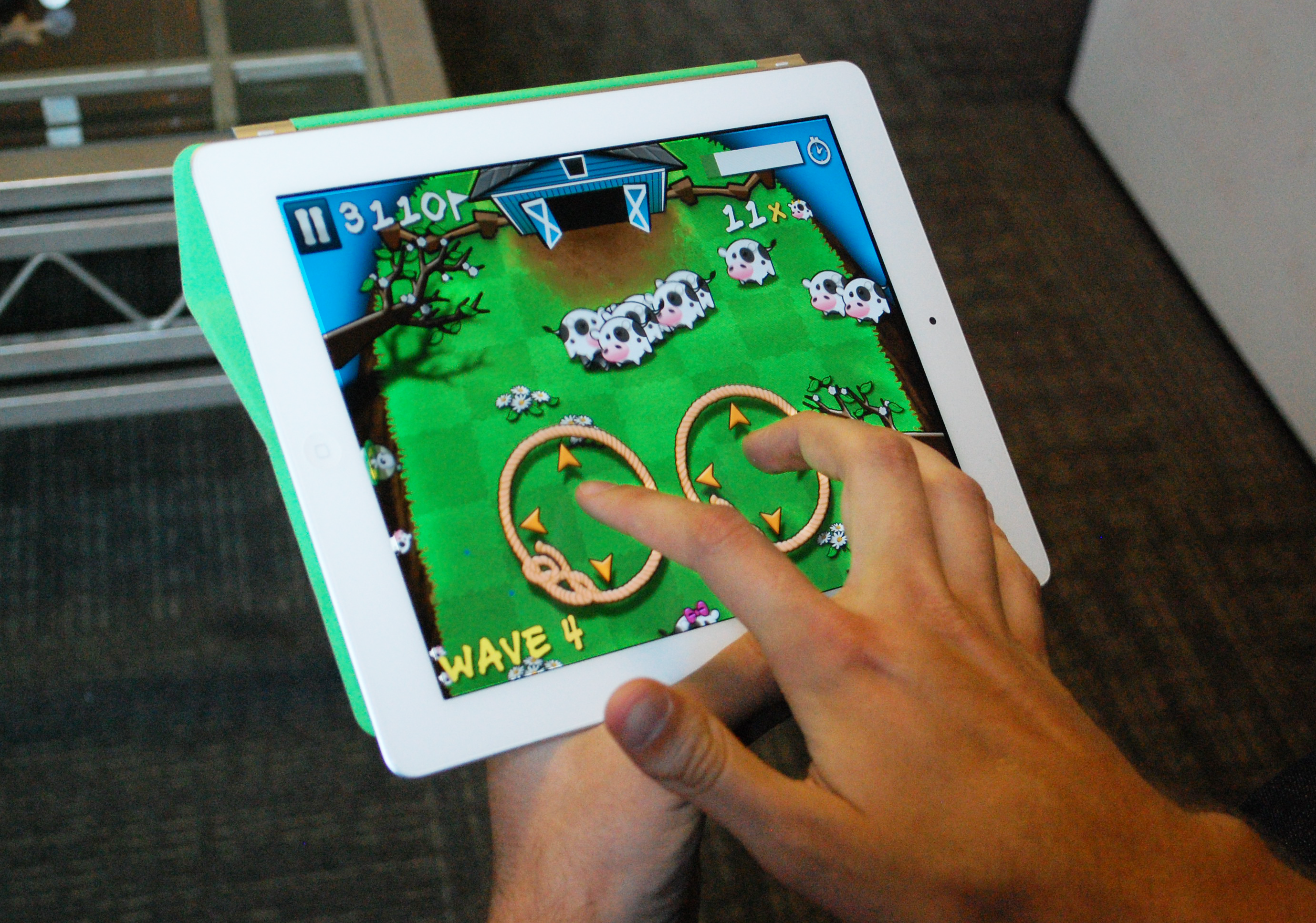 Figure 2-12. Cows vs Aliens is a great game, but the hindrance of the touch mechanic is that fingers, hands are left on the screen for a long time. How can a player spot an alien coming from underneath their hand?